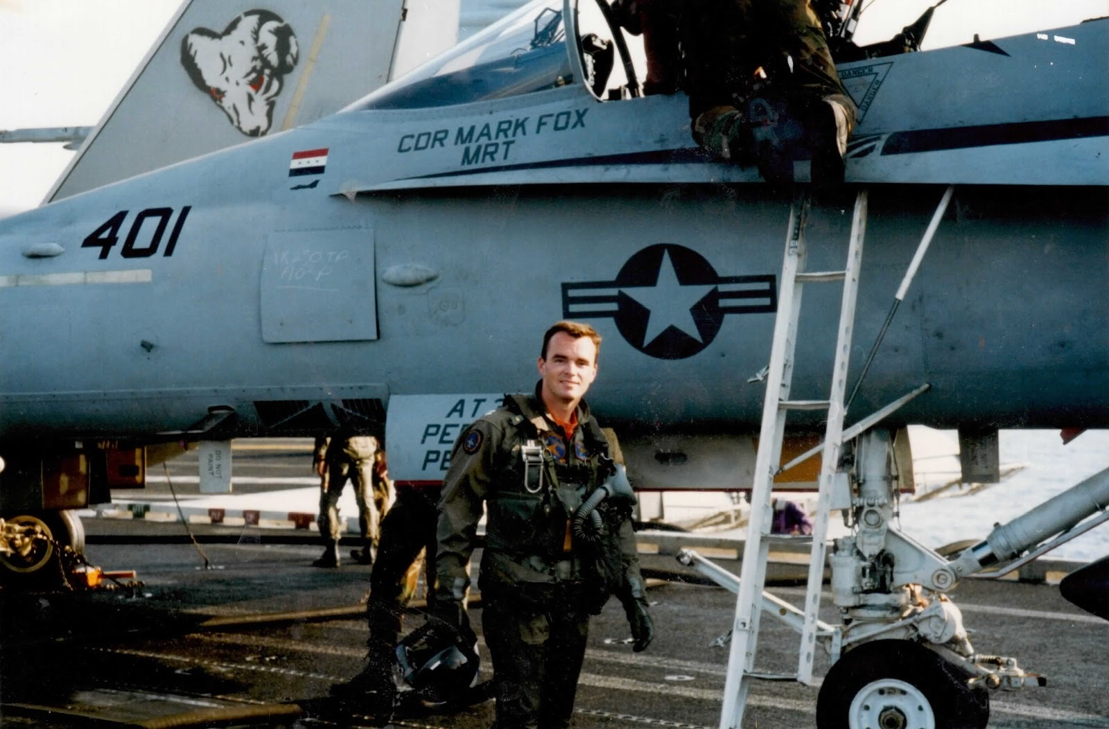 Eric in front of F-14 on aircraft carrier